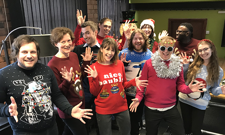 IE team in Christmas jumpers and celebrating UK Charity Week