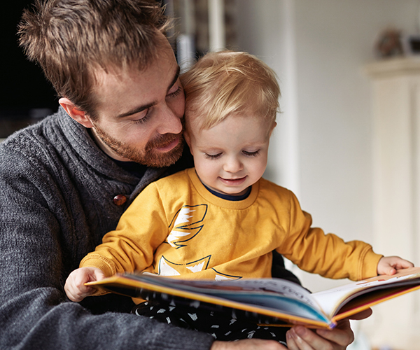A man reading a story with his son